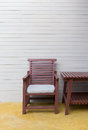 Wooden chair on yellow cement floor with mortar wall Royalty Free Stock Photo