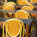 Wooden chairs in an outdoor restaurant Stock Images