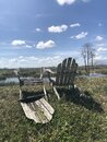 Wooden chairs on the shore of the marsh Royalty Free Stock Photo
