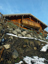 Wooden chalet on the top of a hill Stock Images