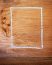 Wooden chalk board background a box outline drawn a for or texture Stock Photography