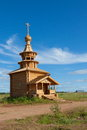 Wooden chapel against the blue sky Stock Image