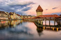 Wooden Chapel Bridge and Water Tower on sunset, Lucerne, Switzer Royalty Free Stock Photo