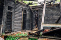 Wooden charred walls of an old abandoned burned-out mansion Royalty Free Stock Photo