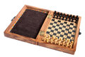 Wooden chessboard with chessmen on a white background Stock Images