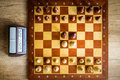 Wooden chessboard with figures on table Stock Images