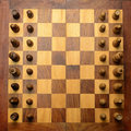 Wooden chessboard top angle of and pieces Stock Images