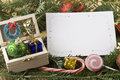 Wooden chest with blank Christmas card Royalty Free Stock Image