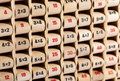 Wooden childs multiplication table close up view of an educational with revolving counters showing the numbers to be Royalty Free Stock Images