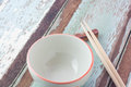 Wooden Chopsticks And Empty Bowl On Wooden Background. Royalty Free Stock Photo