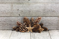 Wooden Chrismas star with cones Royalty Free Stock Photo