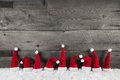 Wooden christmas background with red santa hats for a festive fr Royalty Free Stock Photo