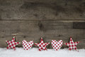 Wooden christmas background with red white checked hearts and st Royalty Free Stock Photo