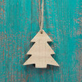 Wooden christmas tree on a old shabby board for a greeting card turquoise Stock Images