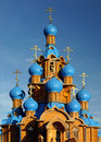 Wooden Church with Blue Domes Stock Photos