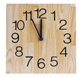 Wooden clock saying five to twelve Stock Photography