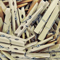Wooden clothes pegs many as a background Royalty Free Stock Images