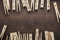 Wooden clothes pegs on the table brown Royalty Free Stock Photos
