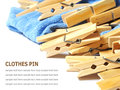 Wooden clothes pin and laundered denim fabric on white clothe background Stock Photo