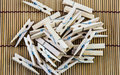 Wooden clothespins close up pile of Royalty Free Stock Photos