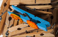 Wooden clothespins group of which projects one blue Royalty Free Stock Photos