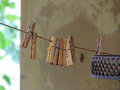 Wooden clothespins some on clothesline Stock Images