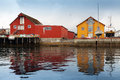 Wooden coastal houses in norwegian village red and yellow fishing Royalty Free Stock Images