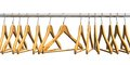 Wooden coat hangers on clothes rail Stock Images
