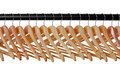 Wooden coat hangers on rail Stock Image