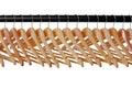 Wooden coat hangers on rail Stock Image