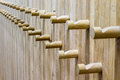 Wooden coat rack a wall from wood whit some in wood Royalty Free Stock Photo
