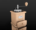 Wooden coffee mill on a black background Royalty Free Stock Images