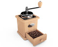 Wooden coffee mill with coffee beans on a white background Royalty Free Stock Image