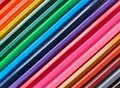 Wooden colored pencils background, close up rainbow style, diagonal layout. Copy space for text Royalty Free Stock Photo