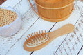 Wooden comb, bucket and bath sponge Royalty Free Stock Photo