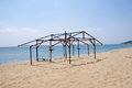 Wooden construction of hut on beach in sunny day Stock Photo