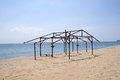 Wooden construction of hut on beach in sunny day Royalty Free Stock Images