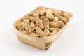 Wooden container is filled with a peanut on a white background Royalty Free Stock Photo