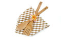 Wooden cooking utensils and flower with brown checkered cloth isolated on white Royalty Free Stock Photo