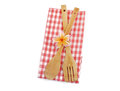 Wooden cooking utensils red checkered cloth isolated white Royalty Free Stock Photography