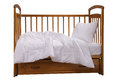 Wooden cot with bedding Royalty Free Stock Photo