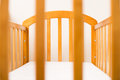 Wooden cot frame for a new baby close up of Royalty Free Stock Photo