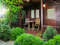 Wooden cottage in the garden Royalty Free Stock Image