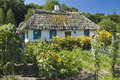 Wooden cottage house and a garden thatched roof green in the countryside Stock Image