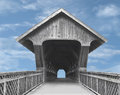 Wooden covered bridge old footbridge isolated against a blue sky with clouds Royalty Free Stock Photos