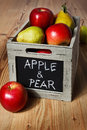 Wooden crate box full of fresh apples and pears Stock Photo
