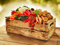 Wooden crate filled with farm fresh vegetables Royalty Free Stock Photo