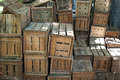 Wooden crates filled with flower bulbs used to overwinter and tubers waiting to be planted in field Royalty Free Stock Photos