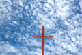 Wooden Cross Against Blue Cloudy Sky Background Royalty Free Stock Photo