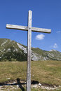 Wooden cross in the alps on mountain beautiful sunny summer day Stock Photo